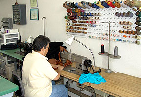 technician sewing a garment at LA Leather Cleaners